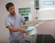 Кабинет литотрипсии областной больницы в Новом. В руках Уролога ТалгатаИмжарова пушка, которой наносятся удары по камням в почках.